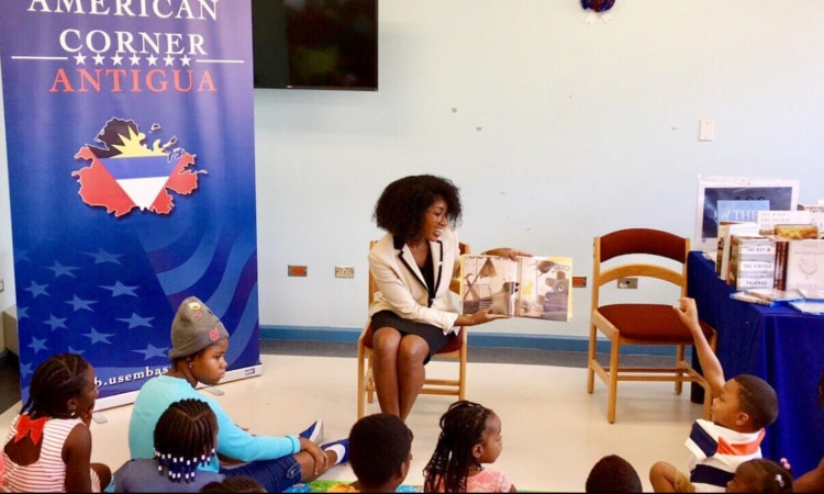 Lady reading book to children